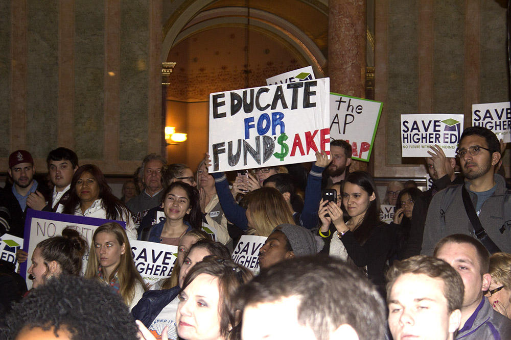 Protesters rally for full funding for  higher education in Illinois at the State Capitol in Springfield on Wednesday.