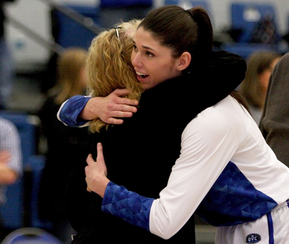 Senior Erica Brown hugs coach Debbie Black prior to her final game in Lantz Arena. Brown is Black's first player to play four years with her and graduate.
