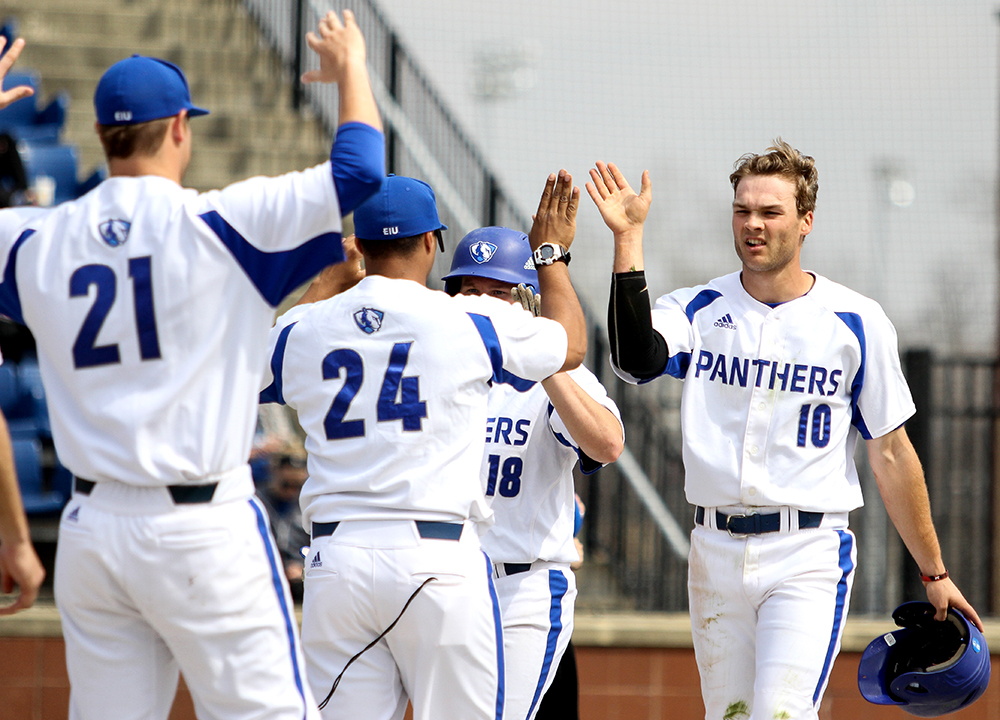 Junior+Joseph+Duncan+is+congratulated+by+teammates+after+hitting+a+home+run+Friday%2C+March+24+at+Coaches+Stadium.+Duncan+finished+the+recent+weekend+series+at+Morehead+State+going+5-13+with+3RBIs+and+5+runs+scored.