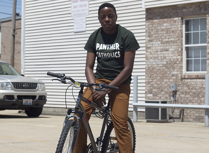 Simon+Walingo%2C+a+graduate+student+from+Uganda%2C+poses+on+his+bike+Monday+afternoon.+Walingo+said+he+plans+on+spending+his+summer+in+Charleston+balancing+a+job+and+an+online+class.
