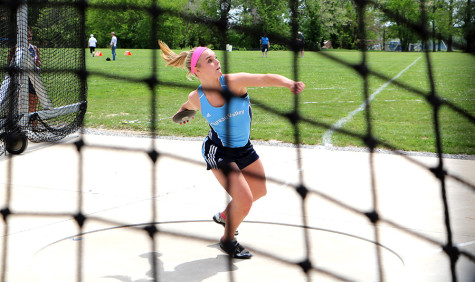 Sydney Lebahn, a junior at Bureau Valley High School, practices throwing the discus during the class 1A semifinals at the IHSA Girls State Final Track Meet Thursday at O'Brien Stadium. Lebahn threw a qualifying throw of 113 feet, 7 inches.