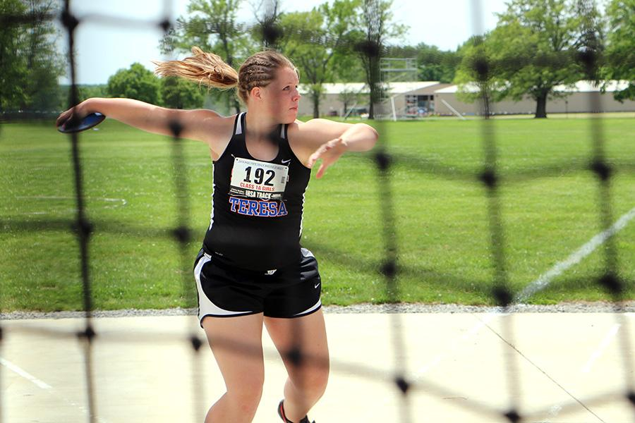 Katie Hise, a sophomore at St. Teresa High School, practices throwing the discus during the class 1A semifinals at the IHSA Girls State Final Track Meet Thursday at O'Brien Stadium. Hise's threw 105 feet, 11 inches in the discus.