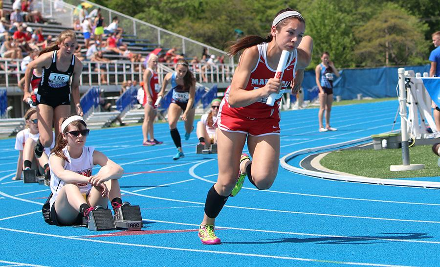 Hannah Jones, a senior at Marshall High School, takes off out of the blocks during the 4x400 meter relay during the class 1A semifinals at the IHSA Girls State Final Track Meet Thursday at O'Brien Stadium. The Marshall relay team finished with a time of 4 minutes, 8 seconds.