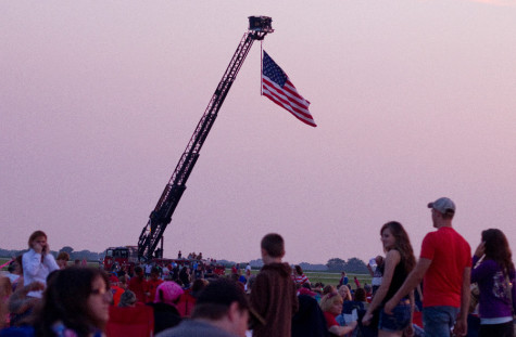The Mattoon Fire Department displays a flag at the Coles County Airport July 4, 2013. Residents from Charleston, Mattoon and surrounding areas gathered for the fireworks show.