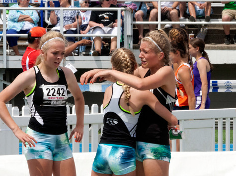 The Washington High School 4x800 meter relay team hugs and cries after they won their Class 2A race during the IHSA Girls State Final Track Meet Saturday at O'Brien Stadium.