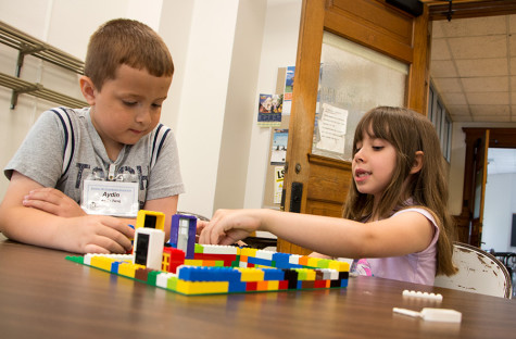 Aydin Tariq and Cheyenne McFarland play with LEGOs during the free playtime at the Beginning Engineering LEGO Camp Tuesday in Room 2231 of Old Main. The beginner's camp allows children ages six to eight to design and build LEGO creations such as cars, catapults and wheelbarrows.