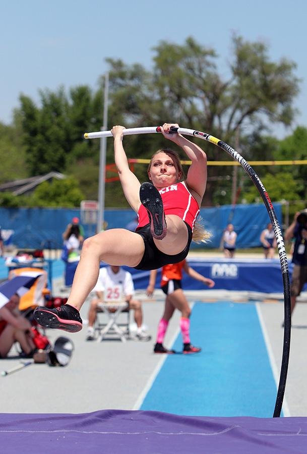 Hannah Swift, a junior at Pekin High School, attempts to clear 10 feet, 6 inch bar for the pole vault event during the Class 3A Semifinals IHSA Girls State Final Track Meet Friday at O'Brien Stadium.