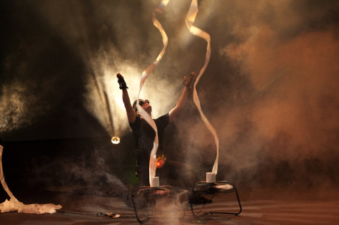 Mark Nizer, a professional juggler, ends his 4D light show with rolls of toilet paper at Eastern Saturday night.