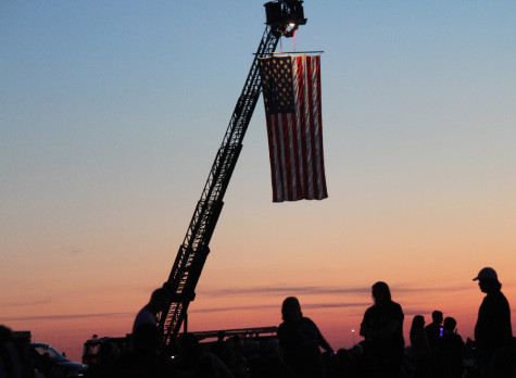 As part of Red, White and Blue Days, the Mattoon Fire Department displays the American flag before the fireworks show begins at the Coles County Airport Friday.