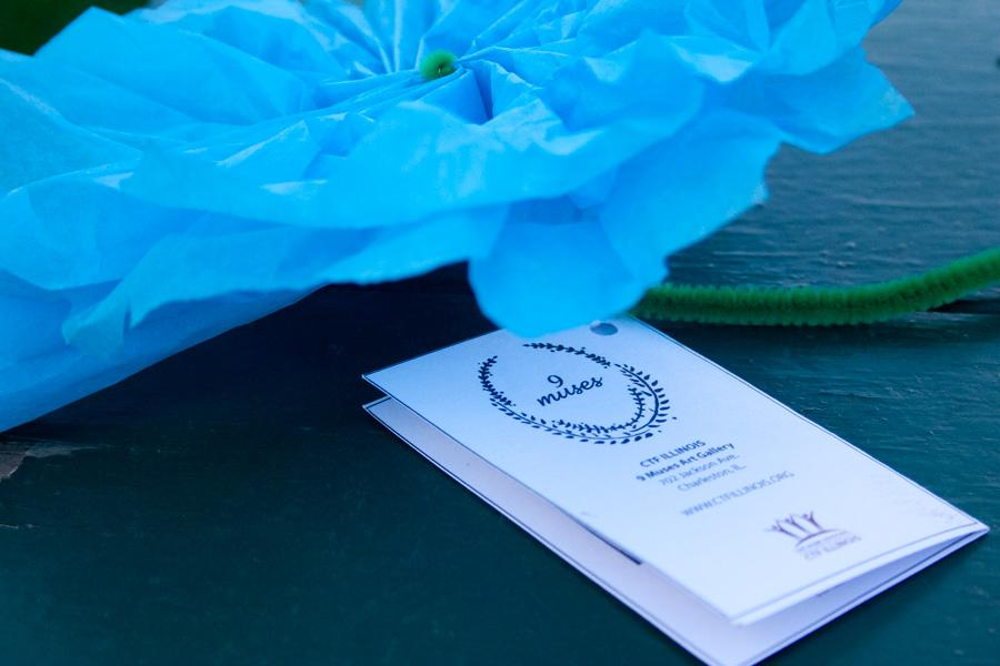 Detail shot of a Blue flower handed out at the celebration