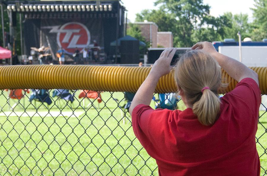 Lady takes picture of loacl band
