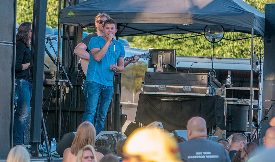 Levi Riggs performs 'God, Guns and Guitars' Thursday at the Red, White and Blue Days celebration in Morton Park.