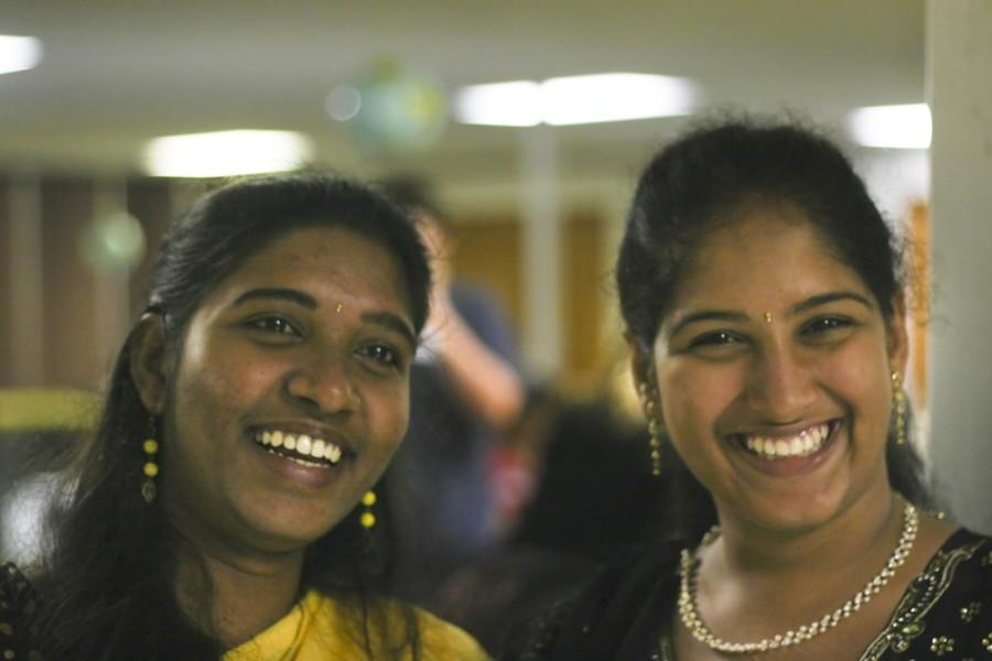 Roberto Hodge | The Daily Eastern News   Kalpana Pinninty and Anusha Pakalapati, both gradute technology majors from India enjoy a laugh at the Curry House event Thursday.