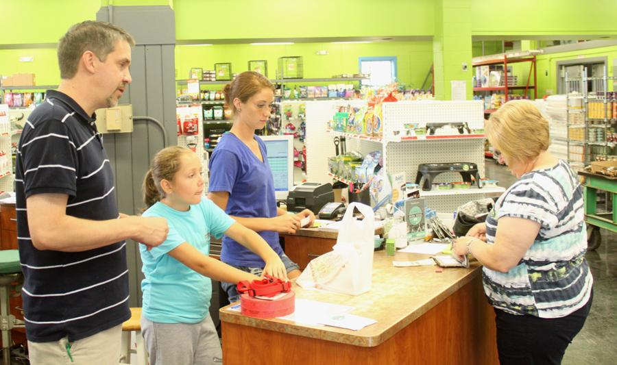Blake Warman | The Daily Eastern News  Owner Mike Corray helps customers at the new store, Fetchers.