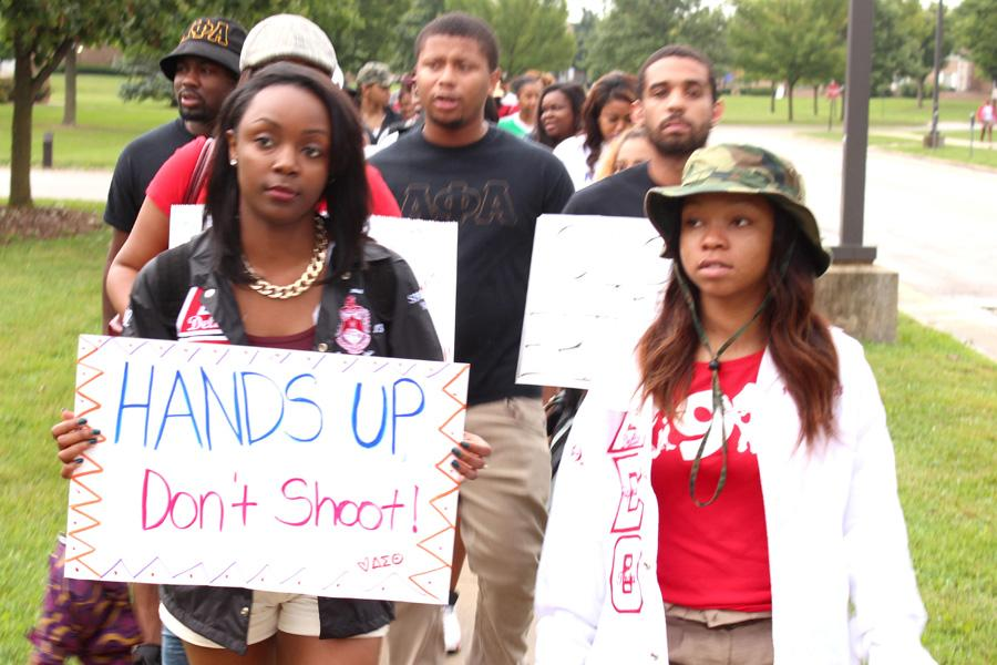 Kevin Hall  The Daily Eastern News   Jalyssa Woodall and Kelsey Hosea ,members of Delta Sigma Theta Sorority inc. lead the march at the