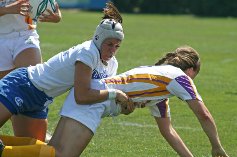 Emalie Thorton, a redshirt sophomore flanker, tackles a Wisconsin All-Star player during a game at Lakeside Field on Sept. 7, 2013.