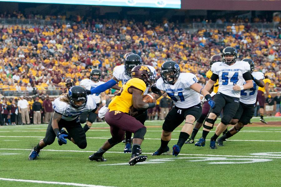 Junior Anthony Goodman (left) and sophomore Seth McDonald (right) converge on Minnesota punt returner Marcus Jones Thursday at TCF Bank Stadium in Minneapolis, Minn. The Panthers lost 42-20 and will host Southern Illinois-Carbondale starting at 6 p.m. Saturday at O'Brien Field.