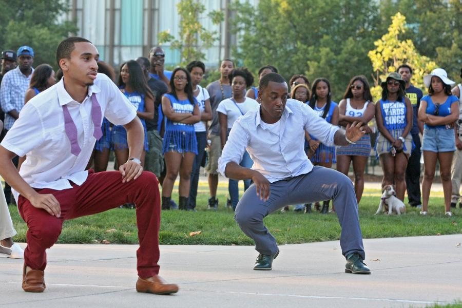 Marvin Collins, a senior Pre-Medicine major, and Jerome Montgomery, a senior Pre-Medicine major, represent their fraternity Kappa Alpha Psi Fraternity, Inc by stepping Friday during the Yard Show on the steps of the Doudna Fine Arts Center.