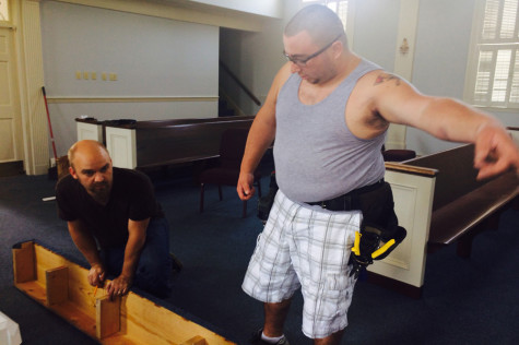 Sam Wheeler, pastor at the Vineyard Church, assists Jayme Grubbs, a volunteer, with measuring where to cut the steps for the layout of their new church.