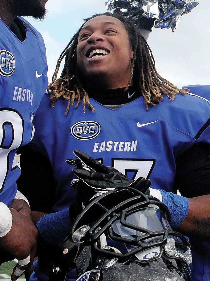 File Photo | The Daily Eastern News Senior defensive back Anthony Goodman celebrates with the rest of the 2013-2014 football team after their win against Tennesse Tech on Nov. 2.
