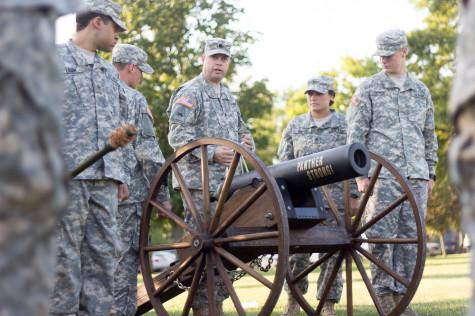Lt. Colonel Eric Savickas goes through the proper steps on cannon operation as the cadets of Eastern's ROTC Panther Battalion become acquainted with it before the first home football game on Saturday at O'Brien Field.  Those who man the cannon, the