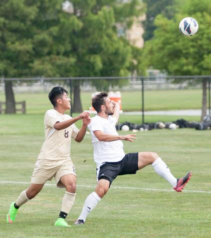 Senior midfielder Will Butler attempts to keep possession of the ball in a game on Aug. 30 at Lakeside Field.  The Panthers beat St. Francis 2-0.  Butler scored the first goal in the game.