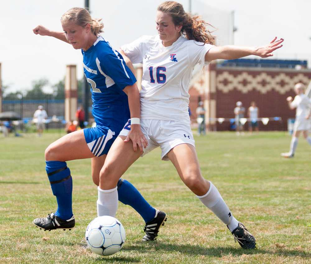 Red-shirt junior forward Chris Reed battles against defender Haley Laque in a game on Sunday at Lakeside Field.  The Panthers lost to the Louisiana Tech Bulldogs 3-1.  The Panthers are 0-4 overall.  Reed was the lone goal scorer for the Panthers.