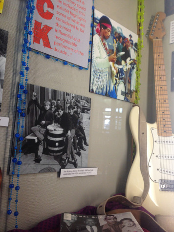 A guitar emulating Jimi Hendrix's left-handed guitar leans on a wall detailing rock in the '60s and the impact it made on music. This display is one of the many in Booth Library setting the scene for this semester's library exhibit focusing on everything to do with the '60s.