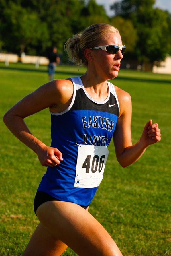 Dominic Baima | The Daily Eastern News Junior Victoria Quarton runs in the Walt Crawlford Open on Friday. Quarton placed third in the meet. The woman's team won the open and the men's team placed second.