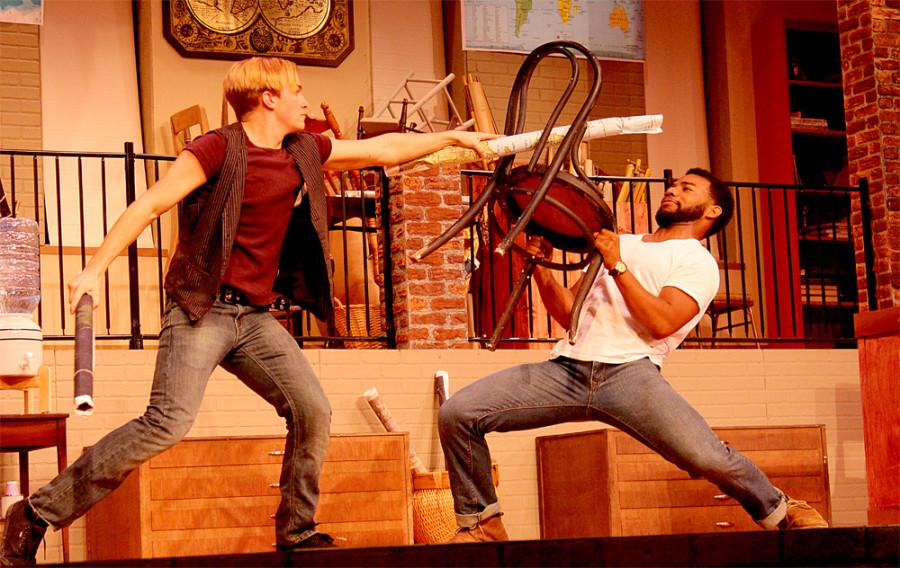 Blake Morris, graduate from Eastern, and Jacob Cole, senior theatre arts major, plays a sword game on the stage of the Doudna Fine Arts Center Wednesday in the production Lonely Planet.