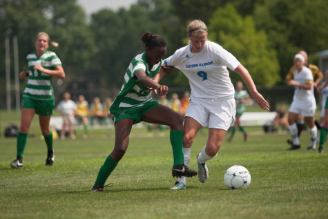 Junior defender Karlee Deacon, defends the ball against Marshall's Sydney Arnold on Aug. 29 at Lakeside Field. The Panthers lost 3-0.