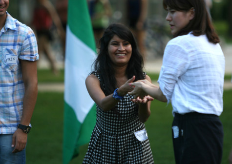 Shova Subedi, a freshman pre-nursing major, and MinJi Cha, a junior communications studies major, play a water balloon toss game during the International Student Welcome Sept. 5 on the South Quad.