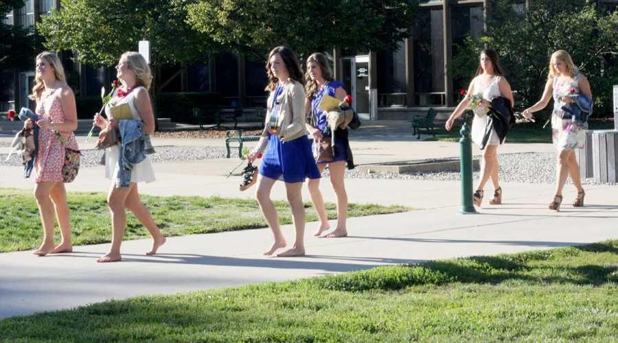 Chynna Miller| The Daily Eastern News    Rush candidates walk through the Library Quad after recieving their bids for Fall Recruitment 2014 Sunday.
