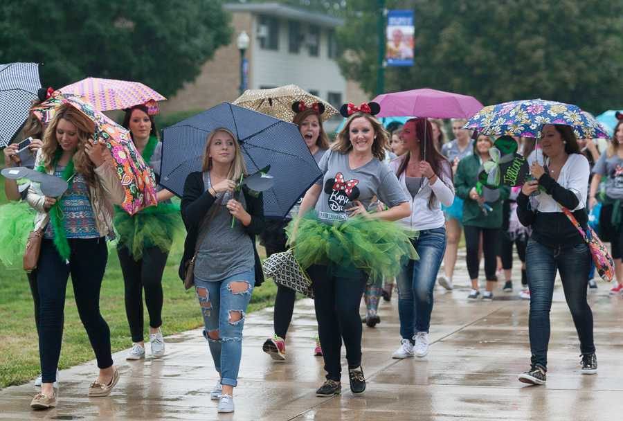 Students with Kappa Delta walk across the Library Quad towards Greek Court after new sorority members received their bids at the end of recruitment on Monday.