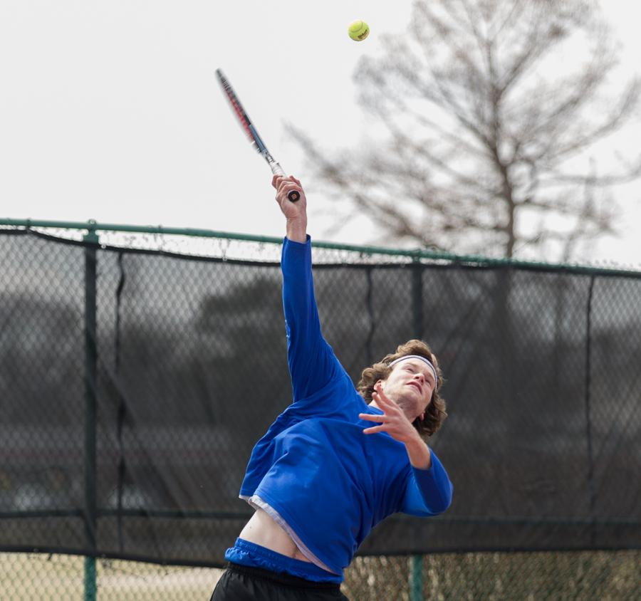 Sophomore+Grant+Thompson+serves+the+ball+during+his+match+against+his+Tennessee+Tech+opponent+on+the+tennis+courts+of+Charleston+High+School+on+March+22.++The+Eastern+men%27s+tennis+team+opened+its+fall+season+at+the+inaugural+EIU+invite+and+hosted+Olivet+Nazarene+and+Missouri-St.+Louis.