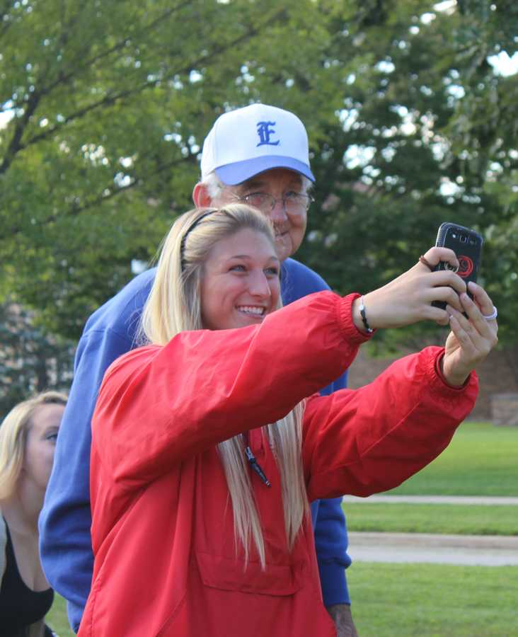 Catie Witt, a sophmore communications major, takes a selfie with President Bill Perry Tuesday during Prowlin with the Prez in Greek Court.