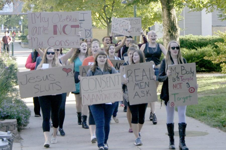 Students chanted and raised hand-written signs during the SLUT Walk on Tuesday while marching past the Biological Sciences building.