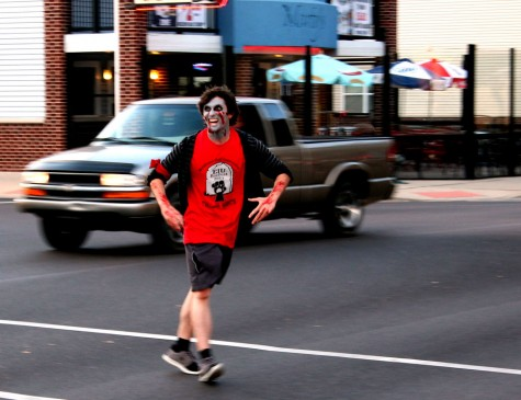Kevin Hall | The Daily Eastern News       Anthony Klaus, an engineering cooperative major, crosses 4th street while trying to tag people playing