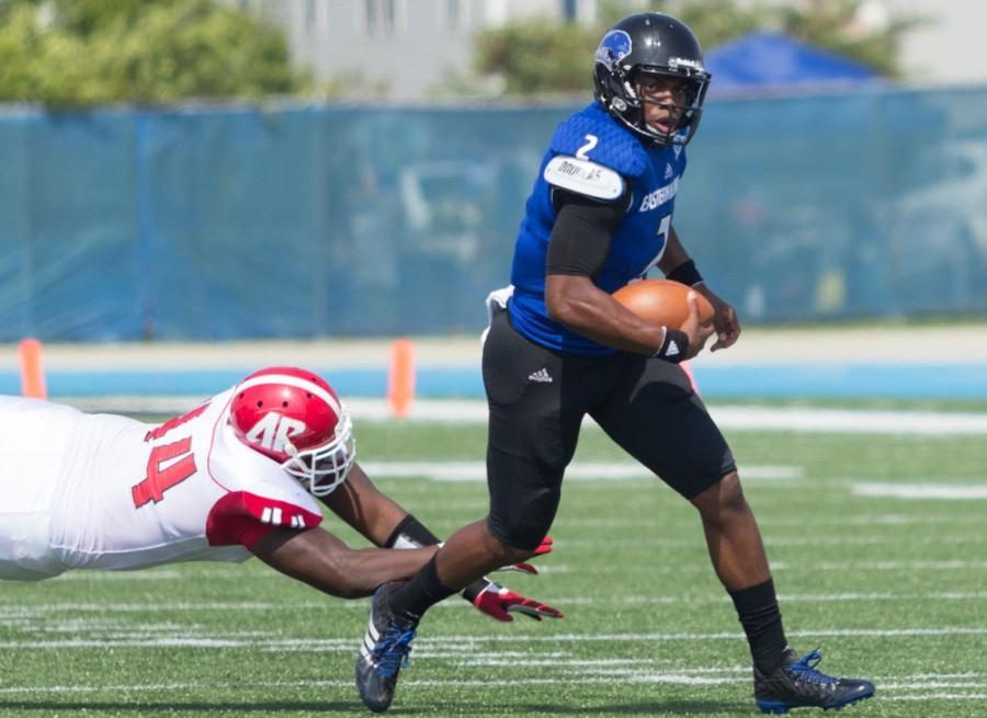 Junior quarterback Jalen Whitlow runs with the ball down field against Austin Peay on Sept. 20 at OBrien Field. Whitlow set an Eastern record, with 137 rushing yards by a quarterback, as the Panthers won 63-7.