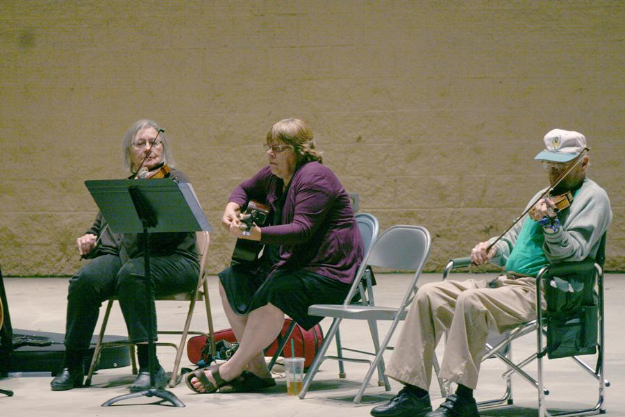 Members of Irish Music Circle perform for free Tuesday at the Daum Ampitheater in Kiwanis Park