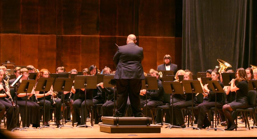 Michael Pond-Jones, a guest conductor and graduate student, leads the EIU Concert Band Thursday in the Dvorak Concert Hall of the Doudna Fine Arts Center.
