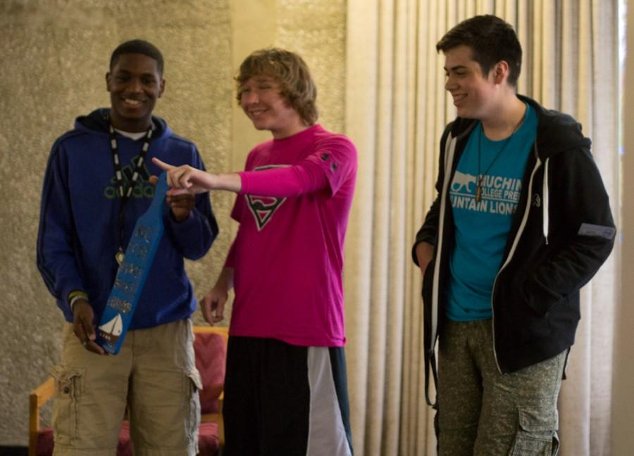 Students+from+Douglas+Hall+receive+the+first+place+paddle+for+winning+the+ROCfest+boat+race+Thursday+in+the+lobby+of+Stevenson+Hall.