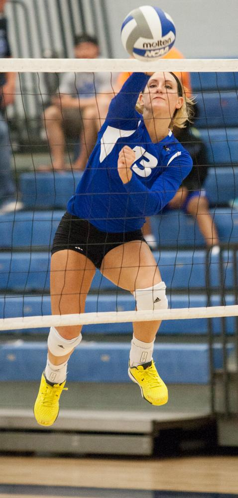 Freshman outside hitter Maria Brown  sends the ball over the net in a game against Southern Illinois-Edwardsville on Wednesday in Lantz Arena.  The Panthers beat the Cougars 3-1 to improve to 1-2 in the OVC and 7-9 overall.  Brown had 8 kills and helped the Panthers score 8.5 points against the Cougars.