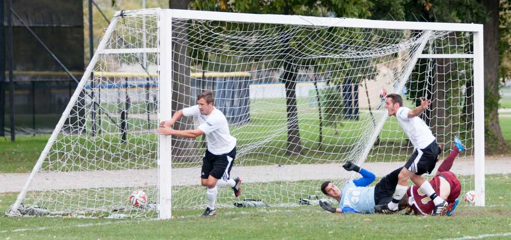 Freshman Dominic Recca (left) sends the ball into the back of the net to give the Panthers the only goal against Denver at the practice field on Saturday.  The game ended in a 1-1 tie and brought the Panthers to 0-1-1 in the OVC and 2-6-1 overall.