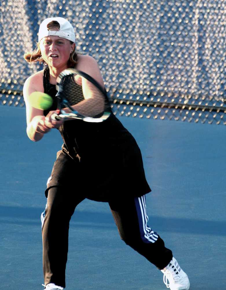 Freshman Grace Summers attempts to hit the ball in her tennis match against Olivet Nazarene Monday at the Darling Courts. Summers went on to win her match.