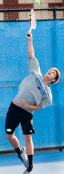 Freshman+Grant+Reiman+serves+the+ball+during+tennis+practice+on+Sept.+30.