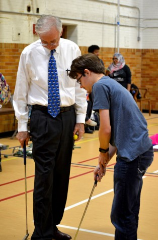 President William Perry and Bradly Ogilvie, a junior mathematics and comupter science major, play putt putt golf during Putt Putt with the Prez Tuesday in McAfee Gymnasium.