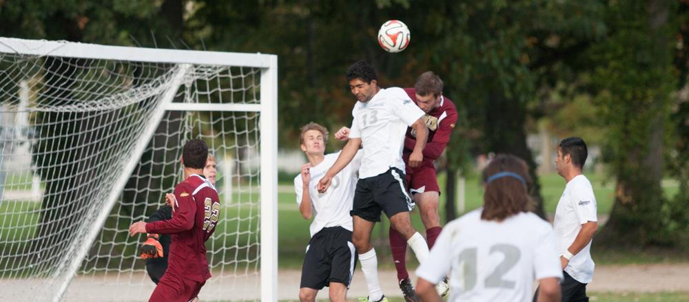 Freshman defender Zach Medawattage attempts to send the ball away from Eastern's goal during a match on Oct. 4 at the Eastern practice field.  The Panthers tied the game 1-1 in double overtime.