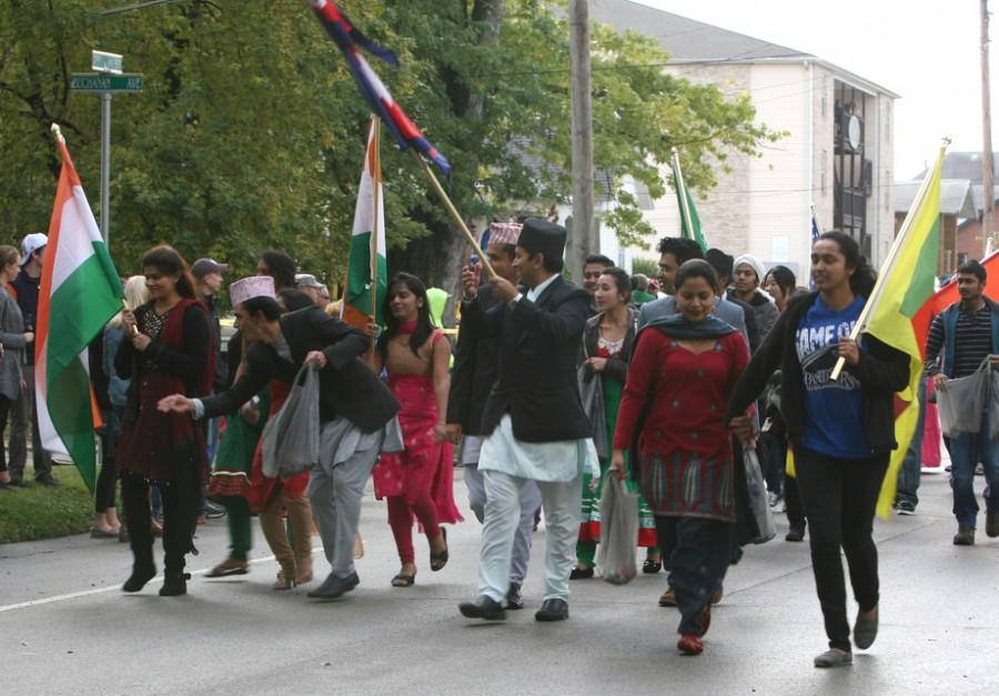 The international students showcase their flags while participating in the Homecoming Parade on October 19, 2013.