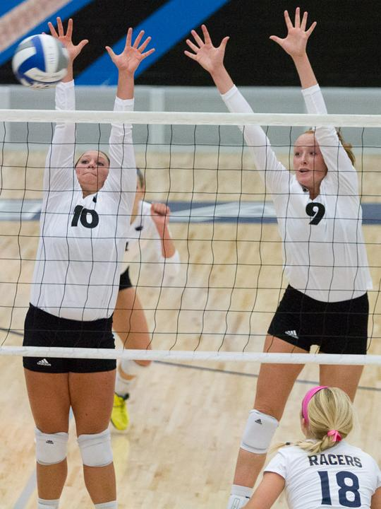 Junior+setter+Marah+Bradbury+and+freshman+middle+hitter+Allie+Hueston+attempt+a+block+against+Murray+State+on+Oct.+10+in+Lantz+Arena.++The+Panthers+lost+to+the+Racers+3-1.